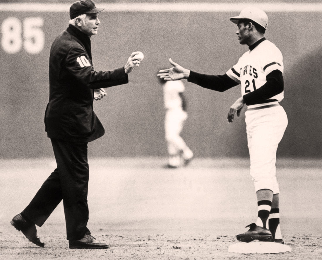 Umpire Dog Harvey with Roberto Clemente